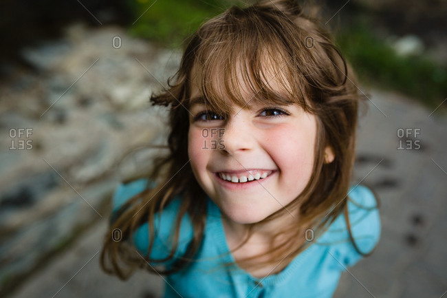 Portrait of a young girl with brown hair smiling