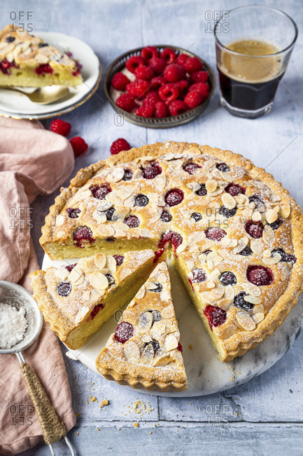 Frangipane tart with rasbierries and blueberries, served with coffee