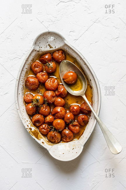 Oven roasted cherry tomatoes set out