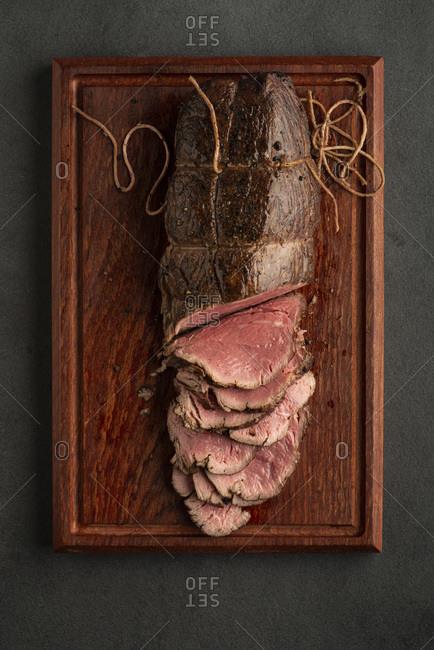 Fillet steak on wood board