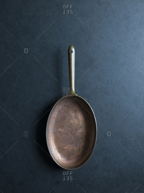 Oval copper pan set out on a table