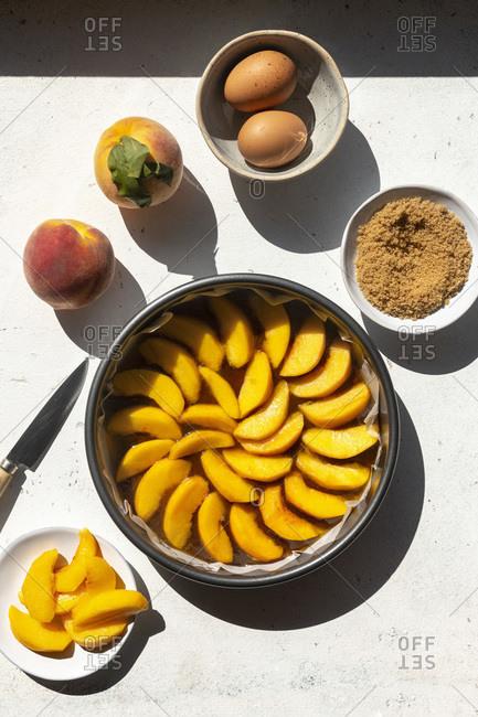 Preparing an upside down peach cake