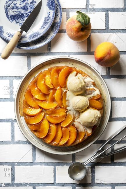 Peach upside down cake on a plate.