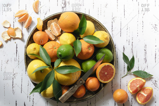 Variety of citrus fruits in a ceramic bowl.