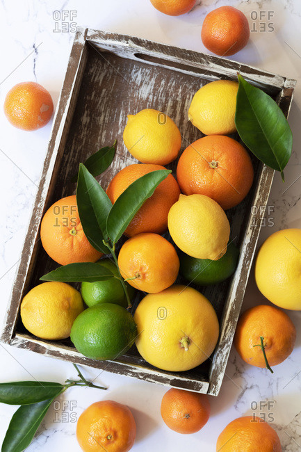 Citrus fruit in a wooden tray.