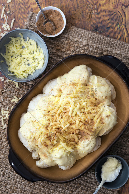 Cauliflower with cheese sauce prepared for baking.
