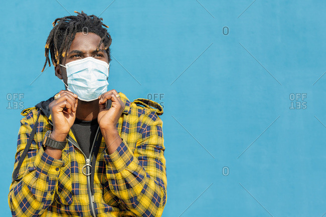 Attractive young african man wearing a protective mask, lifestyle concept and covid protection