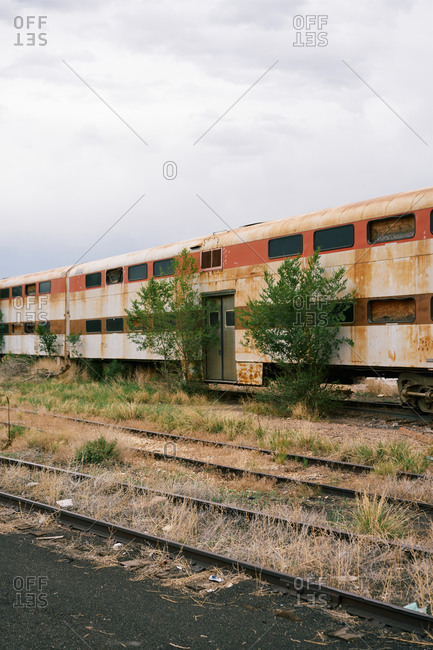 Old train with rusty metal facade located on forgotten railroad on overcast day in USA