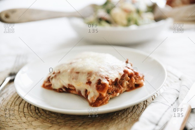 A hearty piece of lasagna served on a plate