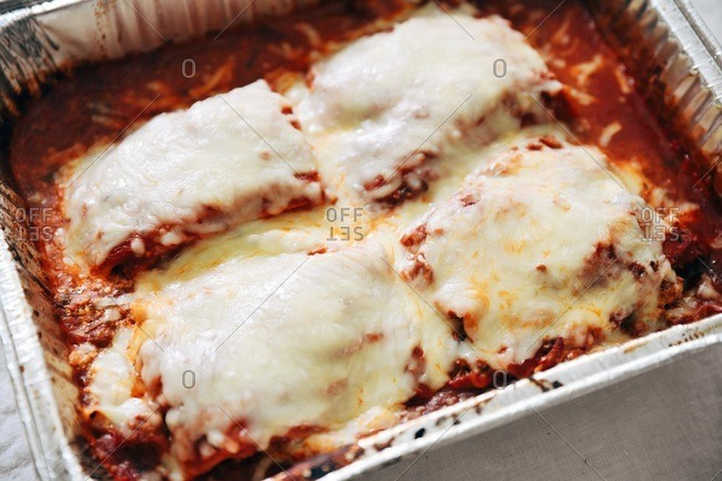 Fresh baked lasagna in a tin baking dish