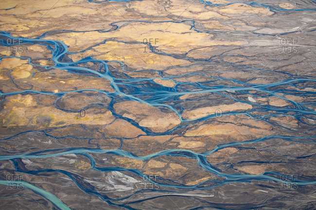 Bird's eye view over blue rivers and streams in rural Iceland