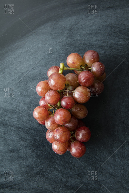Grapes on a dark chalkboard background