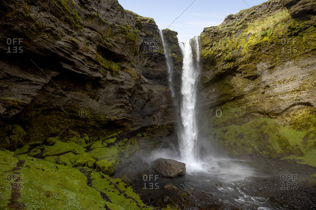 Narrow, big and powerful waterfall in Iceland