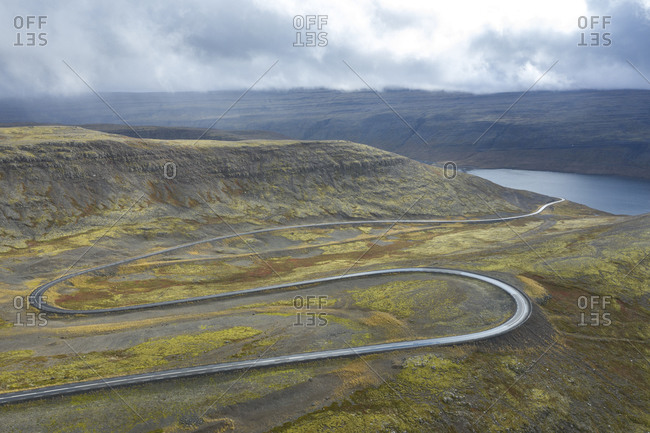 Winding paved mountain road in Iceland
