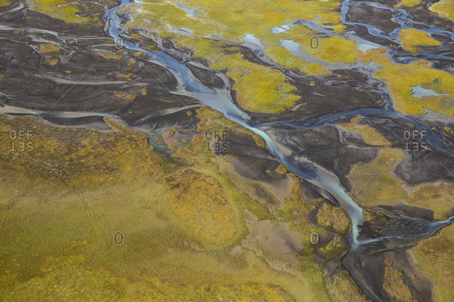 Aerial view of river and streams flowing in Icelandic highlands