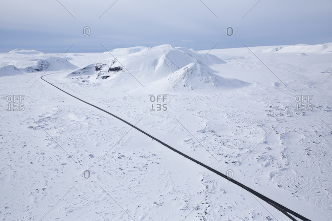 Road through snowy mountains in Iceland
