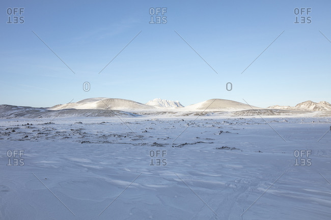Snow covered mountains under blue sky in the highlands of Iceland