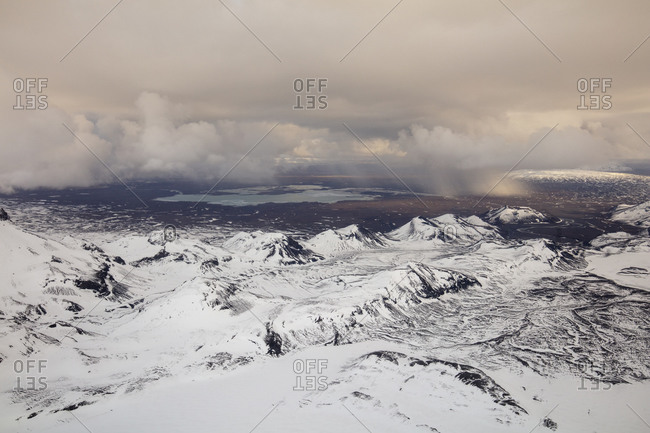 Snow covered mountains under gray skies in Iceland