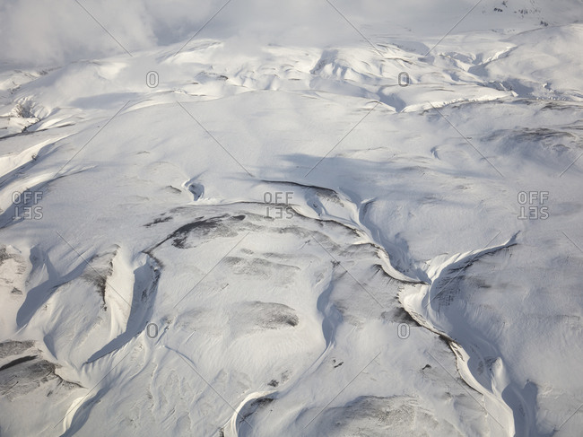Snow covered mountains in rural Iceland seen from above