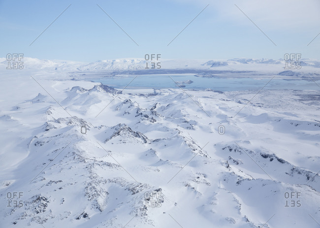 Blue sky over snow covered mountains in rural Iceland
