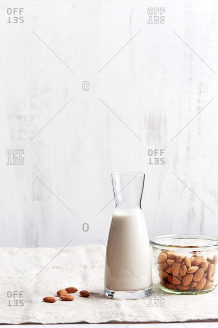 Almonds milk with jar of almonds