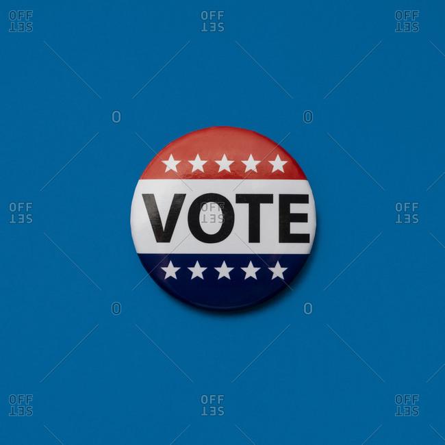 Vote badge on blue background