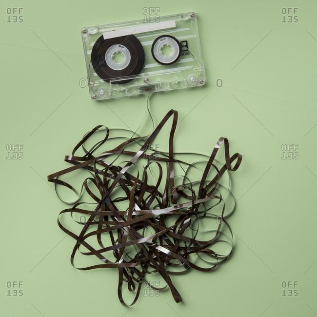 Analog audio cassette on green background