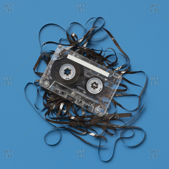 Analog audio cassette on blue background