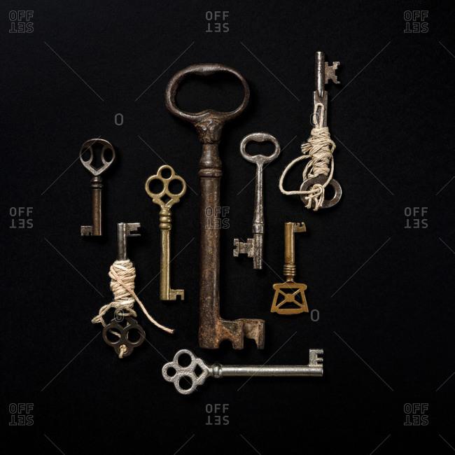 Antique keys on black background