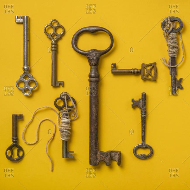 Antique keys on yellow background