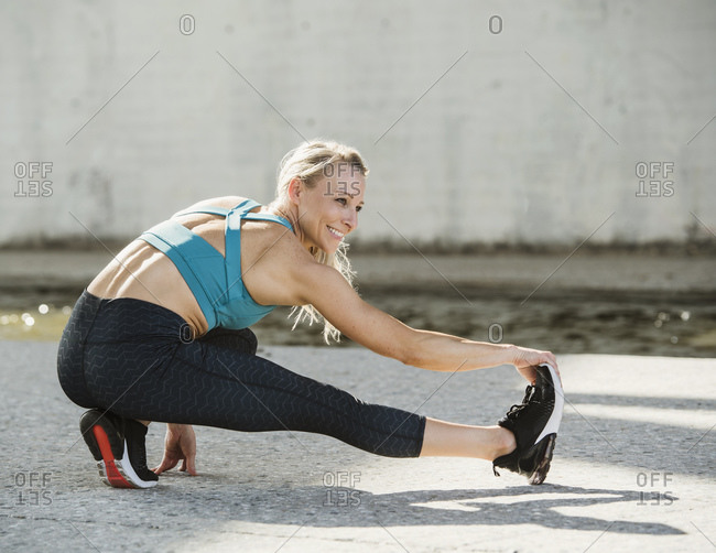 Sporty woman stretching outdoors