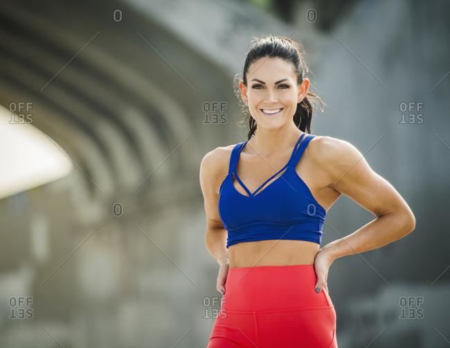 USA, California, Los Angeles, Portrait of woman wearing sports bra