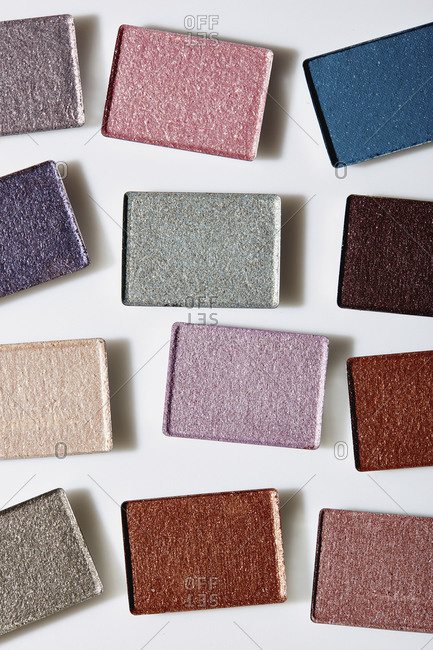 Colorful eye shadows on white background