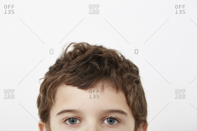 Partial portrait of boy (8-9) with blue eyes