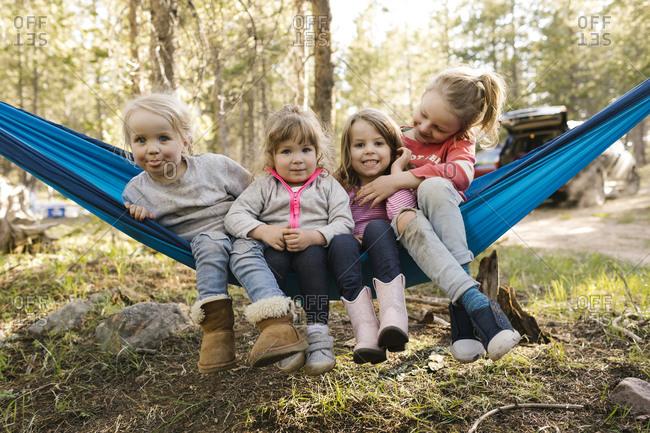 Girls (2-3, 4-5, 6-7) in hammock in Uinta-Wasatch-Cache National Forest