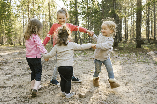 Little girls (2-3, 4-5, 6-7) holding hands and walking in circle Uinta-Wasatch-Cache National Forest