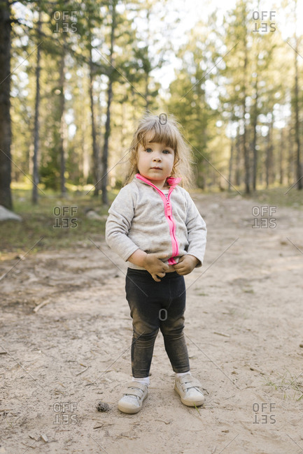 Portrait of girl (2-3) standing on footpath in forest, Wasatch Cache National Forest