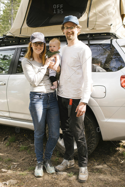 Portrait of parents with baby son (6-11 months) on camping in forest, Wasatch-Cache National Forest