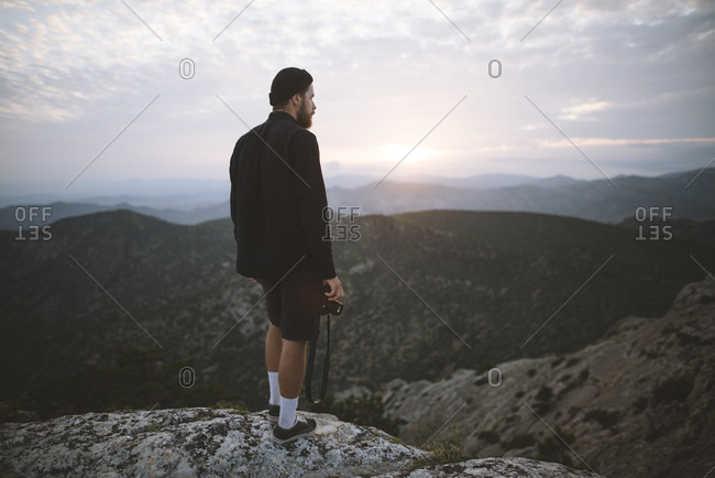 Italy, Liguria, La Spezia, Man looking at mountain range from mountain top