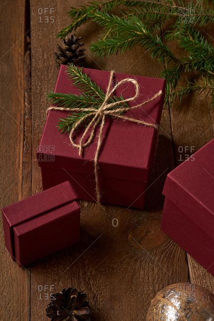 Top view of decorated christmas gifts and boxes with presents on wooden background