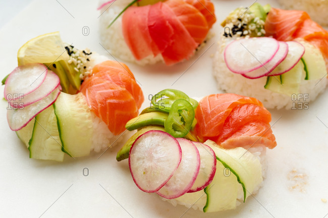 Closeup shot of sushi donuts with salmon and veggies