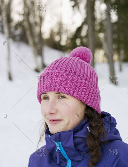 Woman outside in Finland with a pink hat on