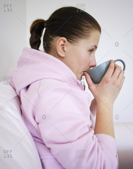 Woman sipping on a cup of tea