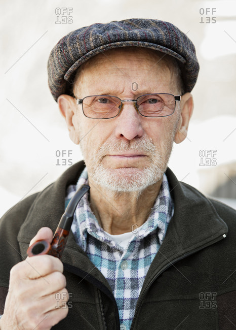 Old man holding his pipe