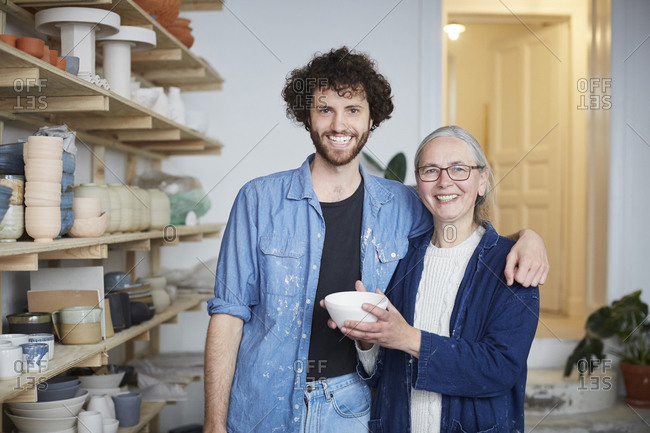 Portrait of smiling man and woman in pottery class