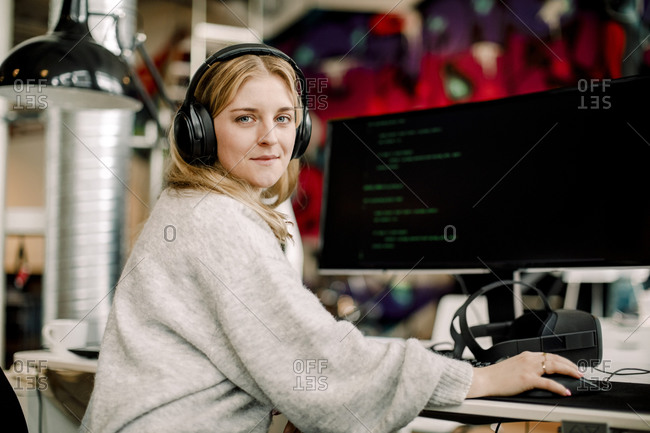 Portrait of female computer programmer sitting in office