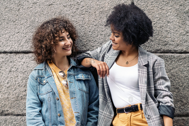 Beautiful African American woman and her Caucasian friend smiling