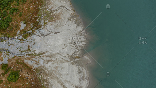 Aerial view of mountains and lakeshore in November in France
