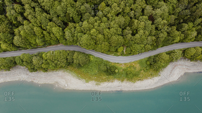 Bird's eye view of Lakeside forest with road in the Pyrenees