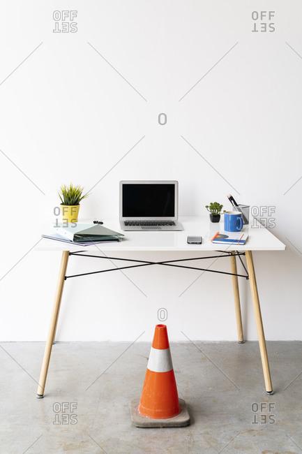 Office desk and orange cone